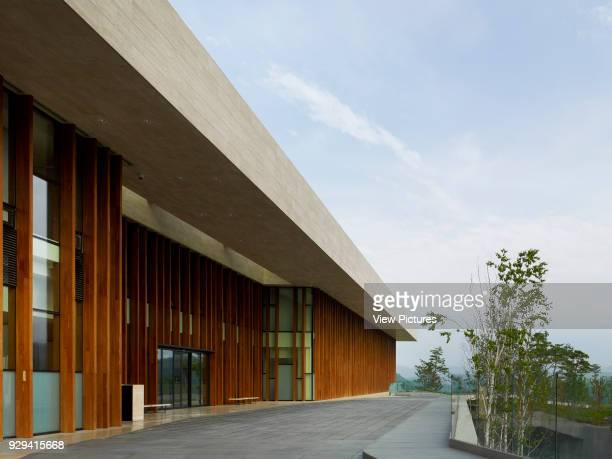 Whistling Rock Golf Clubhouse Chuncheon Korea South Architect Mecanoo 2012 Perspective of exterior timber frame with with travertine canopy plane