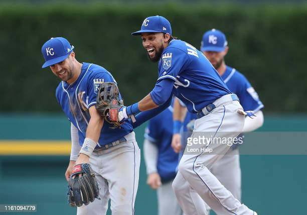 Whit Merrifield and Billy Hamilton of the Kansas City Royals celebrate a win over the Detroit Tigers at Comerica Park on August 11, 2019 in Detroit,...