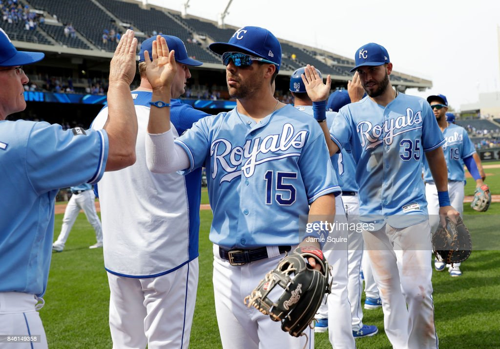Whit Merrifield #15 and Eric Hosmer #35 of the Kansas City Royals high five teammates after the Royals defeated the Chicago White Sox 4-3 to win the game at Kauffman Stadium on September 12, 2017 in Kansas City, Missouri.