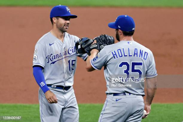 Whit Merrifield and Greg Holland of the Kansas City Royals celebrate a 3-0 victory over the Cleveland Indians at Progressive Field on September 09,...