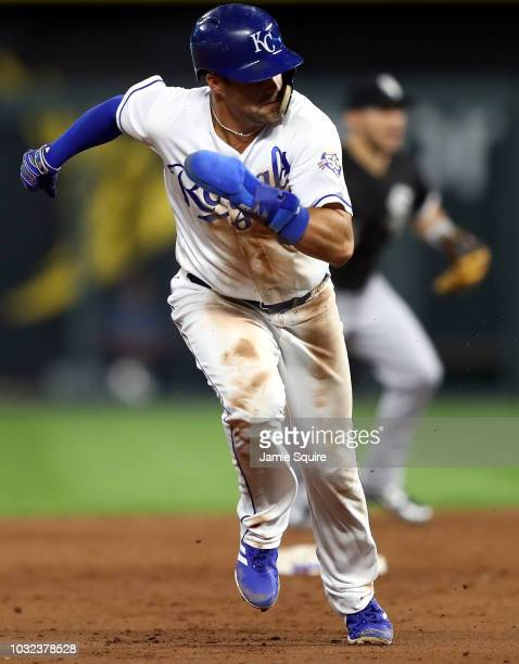 Whit Merrifield of the Kansas City Royals breaks for third during the 3rd inning of the game against the Chicago White Sox at Kauffman Stadium on...