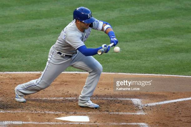 Whit Merrifield of the Kansas City Royals bunts for a single in the third inning against the Los Angeles Angels at Angel Stadium of Anaheim on June...
