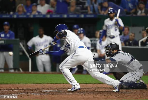 Whit Merrifield of the Kansas City Royals bunts in an RBI during the 7th inning of the game against the Seattle Mariners at Kauffman Stadium on April...