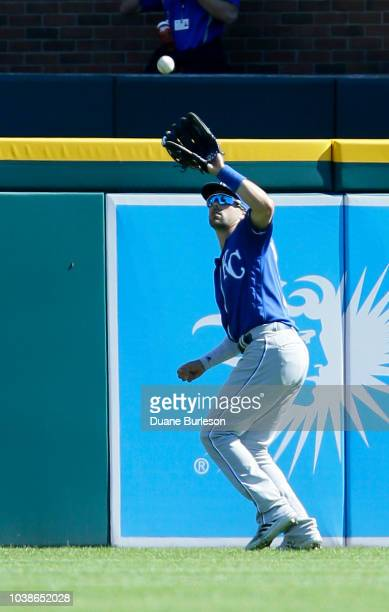 Whit Merrifield of the Kansas City Royals catches a fly ball off the bat of Victor Reyes of the Detroit Tigers during the fifth inning at Comerica...