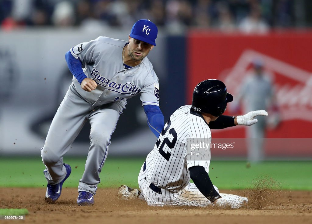 Whit Merrifield #15 of the Kansas City Royals catches Jacoby Ellsbury #22 of the New York Yankees stealing in the eighth inning on May 22, 2017 at Yankee Stadium in the Bronx borough of New York City.