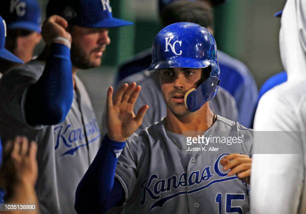 Whit Merrifield of the Kansas City Royals celebrates after scoring on an RBI double in the third inning against the Pittsburgh Pirates during...
