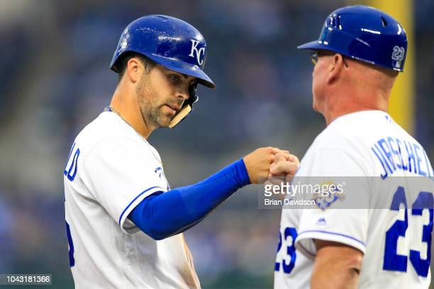 Whit Merrifield of the Kansas City Royals celebrates stealing third base with third base coach Mike Jirschele during the first inning against the...