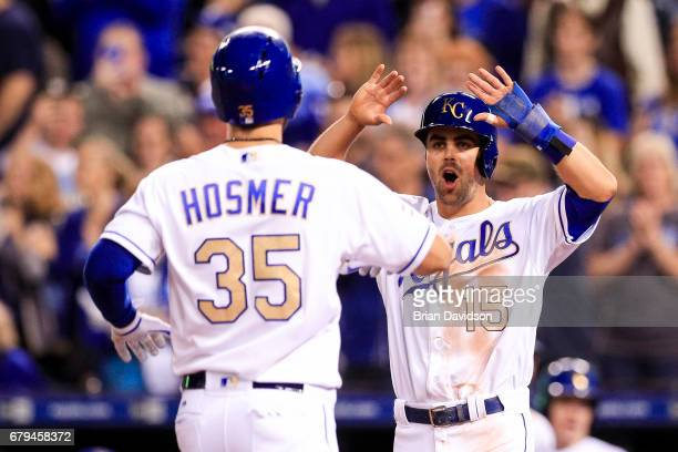 Whit Merrifield of the Kansas City Royals celebrates with Eric Hosmer of the Kansas City Royals after scoring on a Hosmer tworun home run against the...