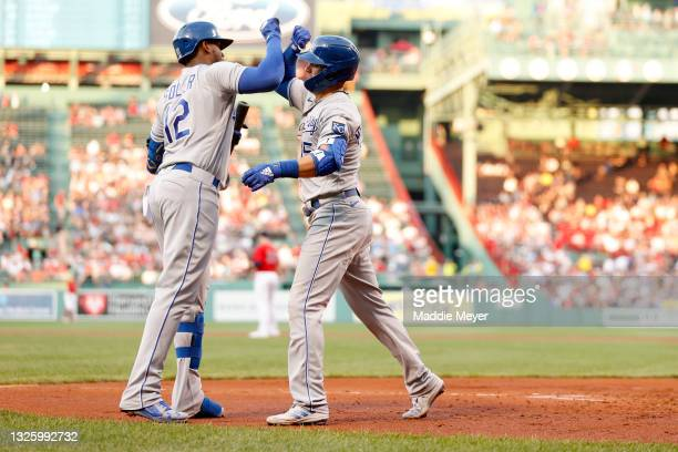 Whit Merrifield of the Kansas City Royals celebrates with Jorge Soler of the Kansas City Royals after hitting a home run against the Boston Red Sox...