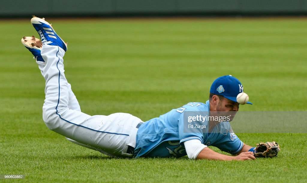 Whit Merrifield #15 of the Kansas City Royals dives for a ball hit by Ronald Torreyes #74 of the New York Yankees in the eighth inning at Kauffman Stadium on May 20, 2018 in Kansas City, Missouri. Torreyes picked up a single on the hit.