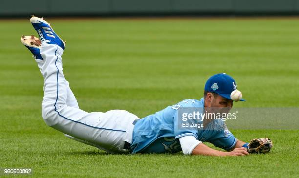 Whit Merrifield of the Kansas City Royals dives for a ball hit by Ronald Torreyes of the New York Yankees in the eighth inning at Kauffman Stadium on...