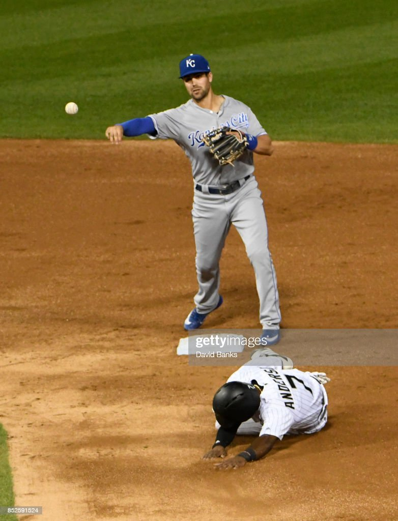 Whit Merrifield #15 of the Kansas City Royals forces out Tim Anderson #7 of the Chicago White Sox at second base during the third inning on September 23, 2017 at Guaranteed Rate Field in Chicago, Illinois.