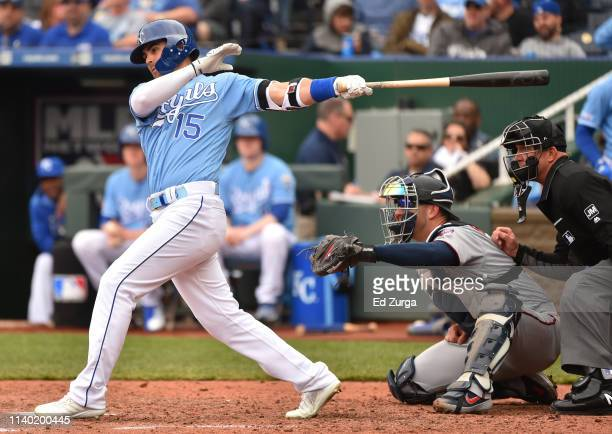 Whit Merrifield of the Kansas City Royals hits a RBI single in the fifth inning against the Minnesota Twins at Kauffman Stadium on April 03 2019 in...