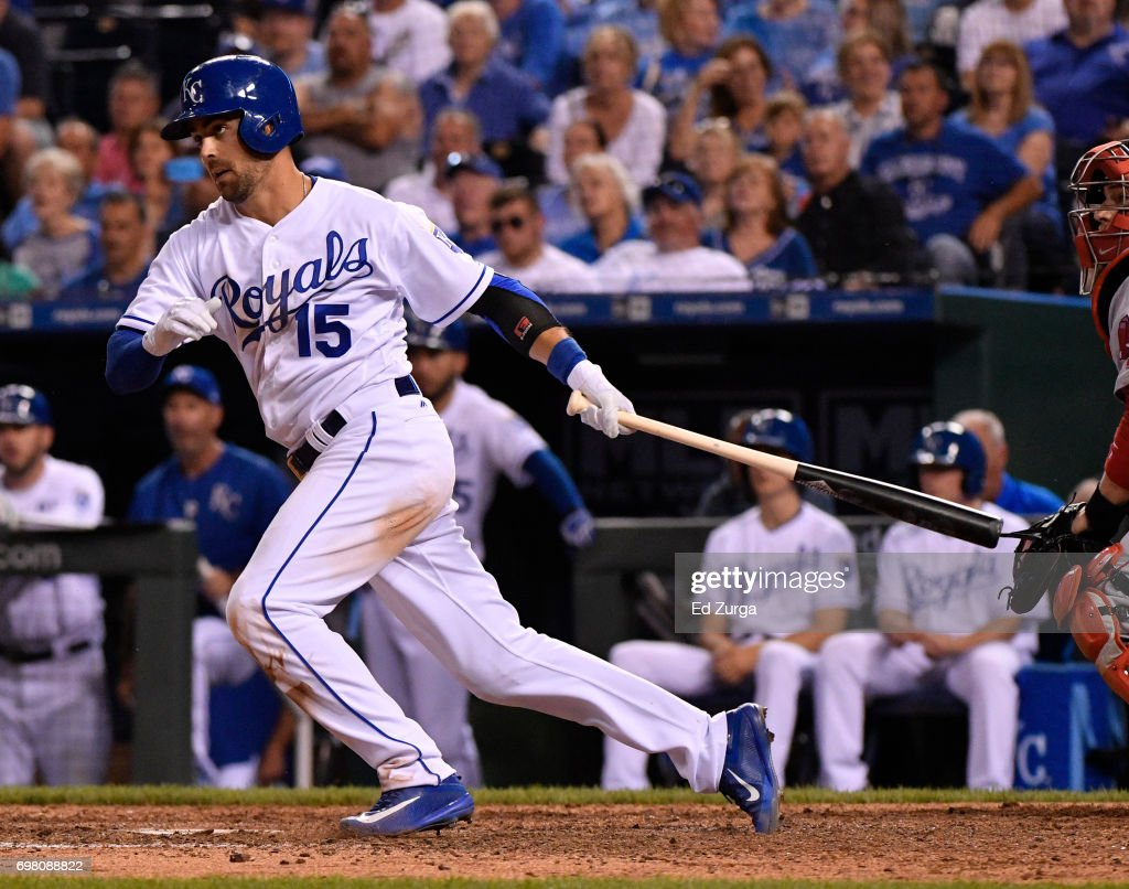 Whit Merrifield #15 of the Kansas City Royals hits a RBI single in the seventh inning against the Boston Red Sox at Kauffman Stadium on June 19, 2017 in Kansas City, Missouri.