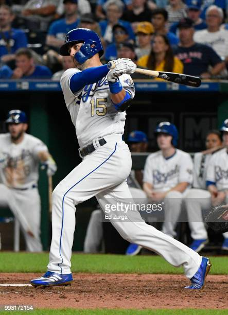 Whit Merrifield of the Kansas City Royals hits a RBI single in the ninth inning against the Boston Red Sox at Kauffman Stadium on July 6 2018 in...