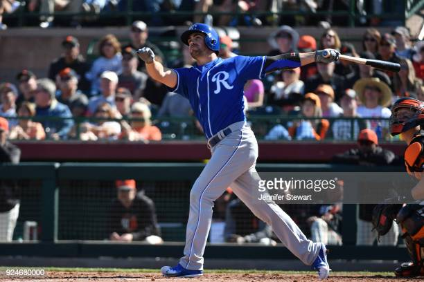 Whit Merrifield of the Kansas City Royals hits a two run homer in the fourth inning of the spring training game against the San Francisco Giants at...