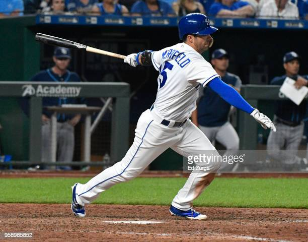 Whit Merrifield of the Kansas City Royals hits a tworun single in the seventh inning against the Tampa Bay Rays at Kauffman Stadium on May 15 2018 in...