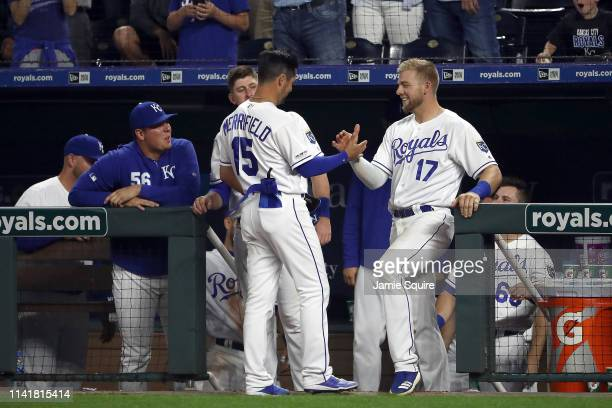 Whit Merrifield of the Kansas City Royals is congratulated by teammates after bunting in an RBI during the 7th inning of the game against the Seattle...