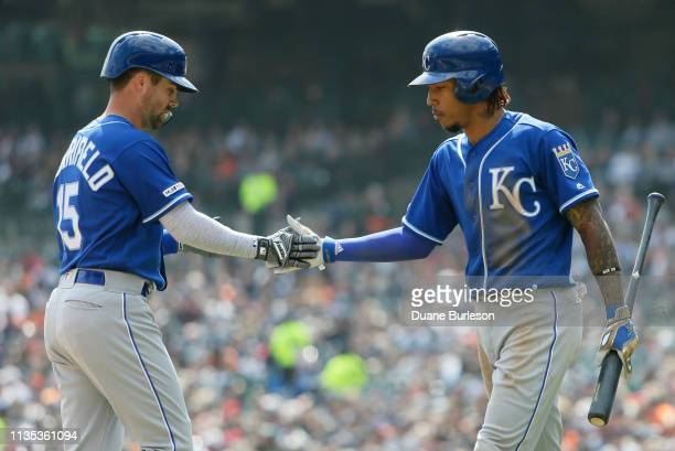 Whit Merrifield of the Kansas City Royals is congratulated by Adalberto Mondesi of the Kansas City Royals after hitting a solo home run against the...