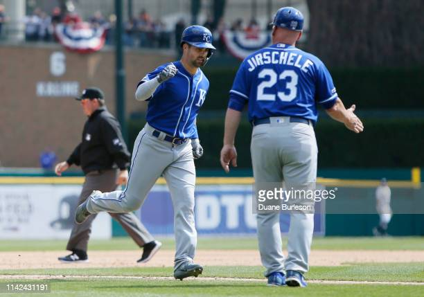 Whit Merrifield of the Kansas City Royals is congratulated by third base coach Mike Jirschele of the Kansas City Royals after hitting a home run at...