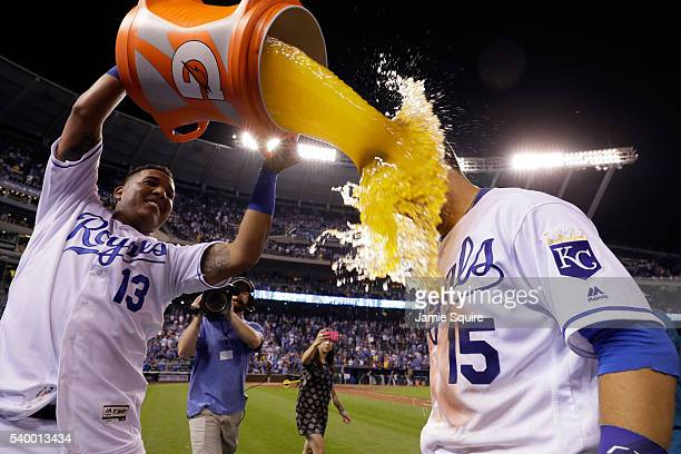 Whit Merrifield of the Kansas City Royals is doused with a bucket of Gatorade by catcher Salvador Perez after the Royals defeated the Cleveland...