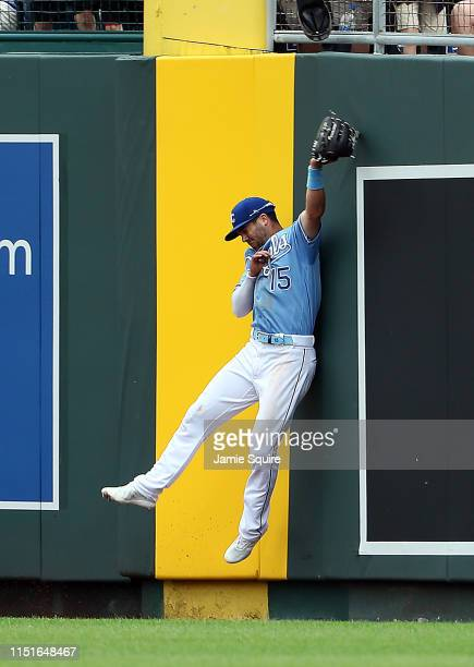 Whit Merrifield of the Kansas City Royals leaps for a fly ball during the 4th inning of the game against the New York Yankees at Kauffman Stadium on...