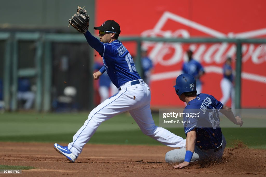 Whit Merrifield #15 of the Kansas City Royals makes the out at second on the sliding Drew Jackson #83 of the Los Angeles Dodgers at Surprise Stadium on February 24, 2018 in Surprise, Arizona.