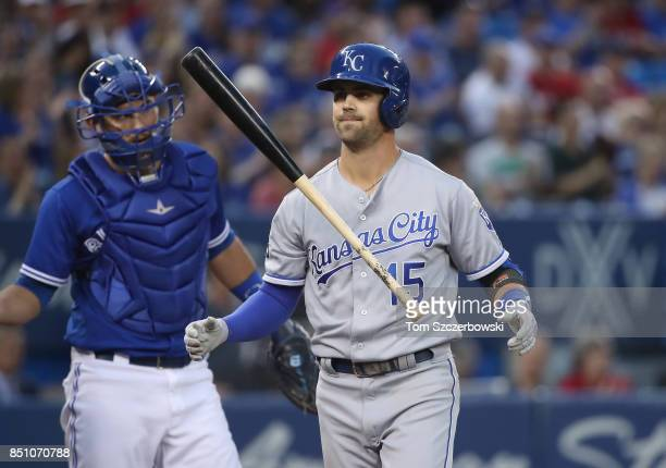 Whit Merrifield of the Kansas City Royals reacts after striking out in the first inning during MLB game action against the Toronto Blue Jays at...