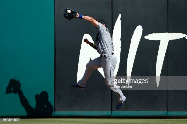 Whit Merrifield of the Kansas City Royals robs Nomar Mazara of the Texas Rangers of a hit during the fifth inning at Globe Life Park in Arlington on...