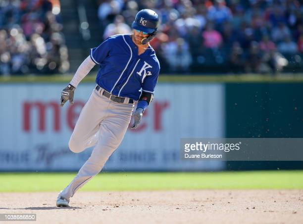 Whit Merrifield of the Kansas City Royals rounds second base on a triple against the Detroit Tigers during the ninth inning at Comerica Park on...