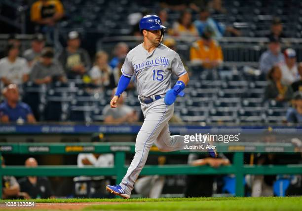 Whit Merrifield of the Kansas City Royals scores on an RBI double in the third inning against the Pittsburgh Pirates during interleague play at PNC...