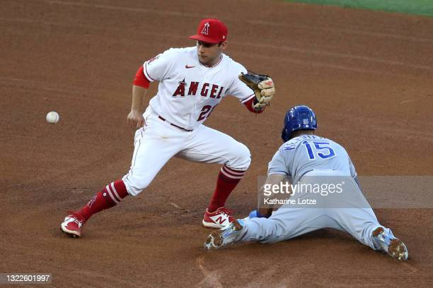 Whit Merrifield of the Kansas City Royals slides into second as David Fletcher of the Los Angeles Angels tries to tag him out in the third inning at...
