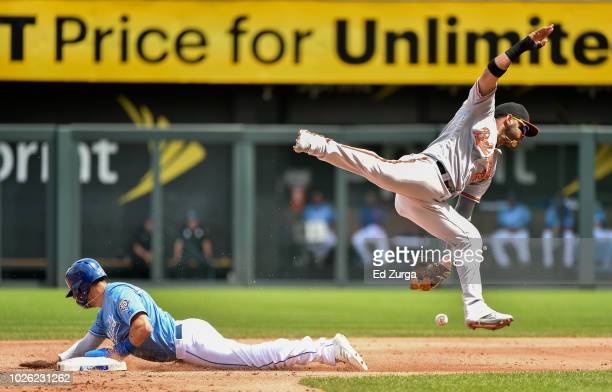 Whit Merrifield of the Kansas City Royals slides into second for a steal past shortstop Jonathan Villar of the Baltimore Orioles in the third inning...