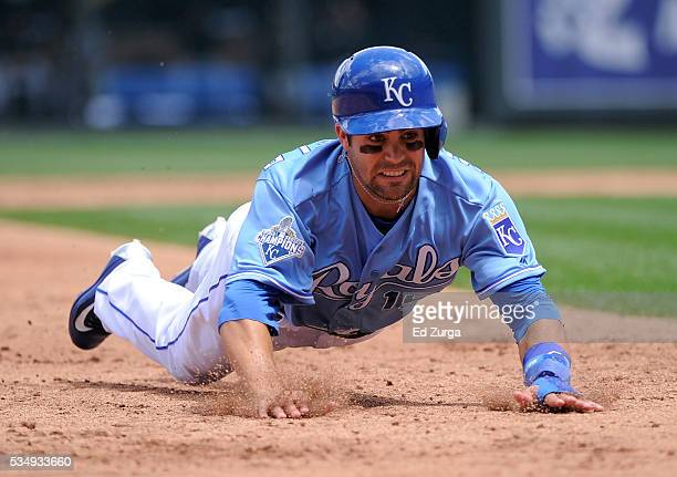 Whit Merrifield of the Kansas City Royals slides into third for a steal against the Chicago White Sox at Kauffman Stadium on May 28 2016 in Kansas...