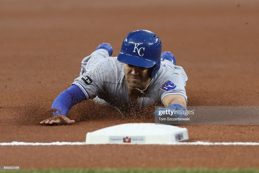 Whit Merrifield #15 of the Kansas City Royals slides safely into third base sa he steals third in the first inning during MLB game action against the Toronto Blue Jays at Rogers Centre on September 20, 2017 in Toronto, Canada.