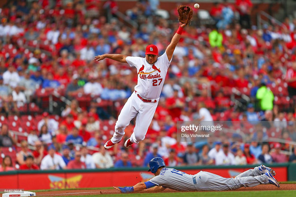 Whit Merrifield #15 of the Kansas City Royals steals third base against Jhonny Peralta #27 of the St. Louis Cardinals in the first inning at Busch Stadium on June 30, 2016 in St. Louis, Missouri.