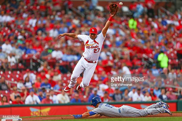 Whit Merrifield of the Kansas City Royals steals third base against Jhonny Peralta of the St Louis Cardinals in the first inning at Busch Stadium on...