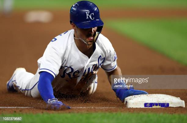 Whit Merrifield of the Kansas City Royals steals third during the 5th inning of the game against the Chicago White Sox at Kauffman Stadium on...