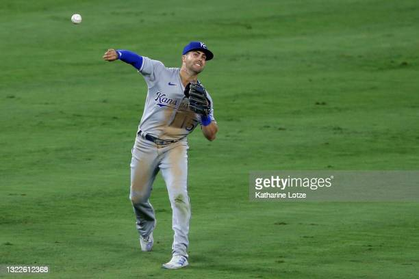 Whit Merrifield of the Kansas City Royals throws from left field during the eighth inning against the Los Angeles Angels at Angel Stadium of Anaheim...