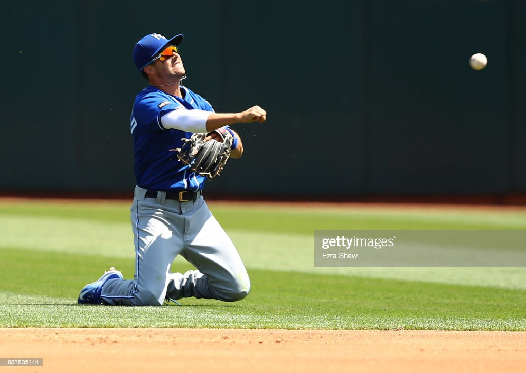 Whit Merrifield #15 of the Kansas City Royals throws out Jed Lowrie #8 of the Oakland Athletics in the third inning at Oakland Alameda Coliseum on August 16, 2017 in Oakland, California.