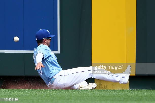 Whit Merrifield of the Kansas City Royals unsuccessfully slides for a fly ball off the bat of Brett Gardner of the New York Yankees during the 5th...