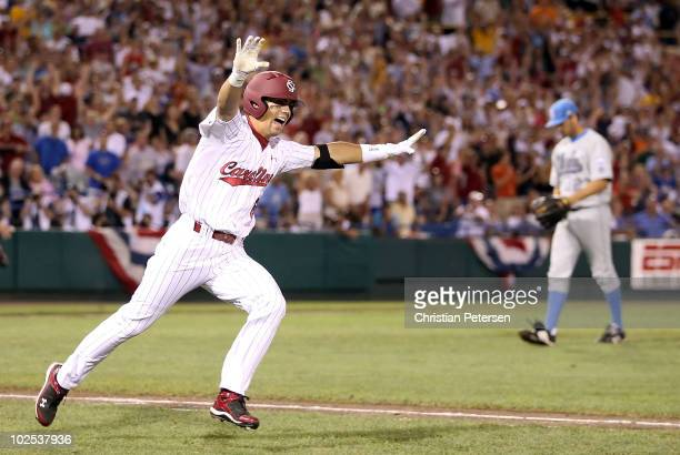 Whit Merrifield of the South Carolina Gamecocks celebrates after hitting the game winning RBI off pitcher Dan Klein of the UCLA Bruins to win game 2...