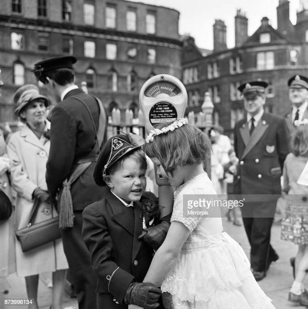 Whit Monday walks in Collyhurst Manchester A demonstration of affection between Terrance Coltan aged 7 and Deidre Cairns aged 7 walking with St...