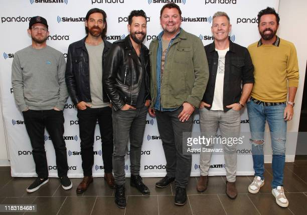 Whit Sellers Geoff Sprung Matthew Ramsey Storme Warren Trevor Rosen and Brad Tursi pose for photos during SiriusXM's Town Hall with Old Dominion at...