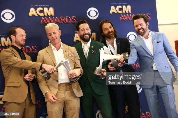 Whit Sellers Trevor Rosen Matthew Ramsey Geoff Sprung and Brad Tursi of musical group Old Dominion winners of the Vocal Group of the Year award pose...