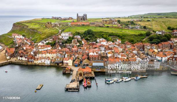 whitby abbey and village - christianity stock pictures, royalty-free photos & images