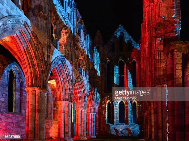 Whitby Abbey is illuminated for Whitby's Goth Weekend when visitors can walk amongst the Abbey ruins which inspired Bram Stoker's Dracula at Whitby...