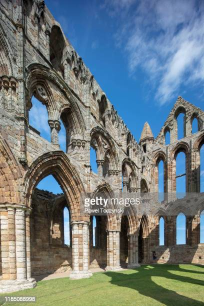 whitby abbey ruins - destroyed during the dissolution of the monasteries in 16th century, whitby, england, 2018 - british royalty photos stock pictures, royalty-free photos & images