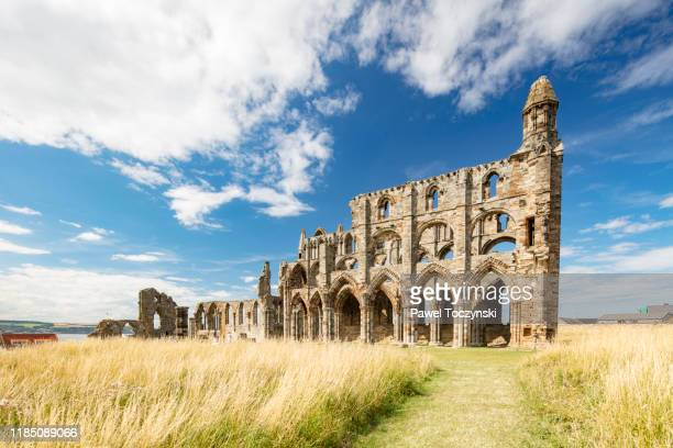 whitby abbey ruins - destroyed during the dissolution of the monasteries in 16th century, whitby, england, 2018 - british royalty stock pictures, royalty-free photos & images