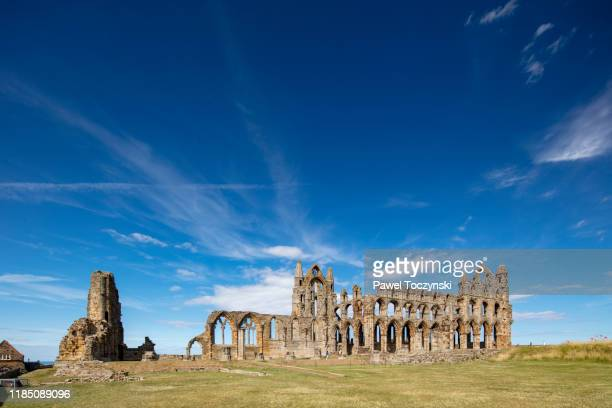 whitby abbey ruins - destroyed during the dissolution of the monasteries in 16th century, whitby, england, 2018 - history stock pictures, royalty-free photos & images